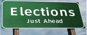 Green sign with the words Elections Just Ahead